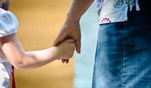 kids holding hands - slider